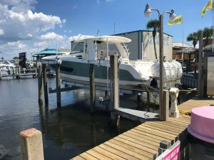40,000 LB Golden Boat Lift with a Boston Whaler Outrage 420